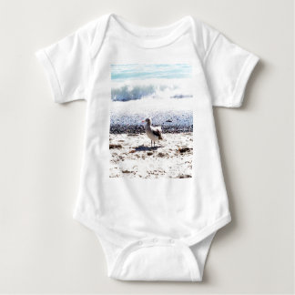 seagull by the ocean on the beach picture baby bodysuit