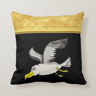 Seagull flying over head with a gold foil design cushion