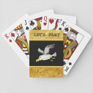 Seagull flying over head with a gold foil design playing cards