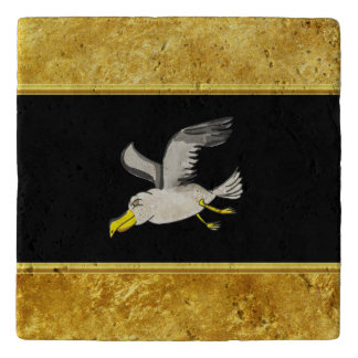 Seagull flying over head with a gold foil design trivet