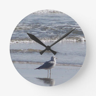 Seagull On The Beach at low tide on east coast Round Clock