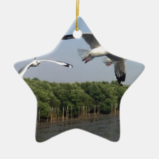 Seagulls at the beach ceramic ornament