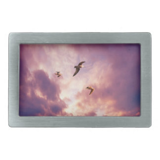 Seagulls flying in a sunset sky belt buckles
