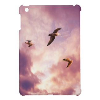 Seagulls flying in a sunset sky iPad mini cover