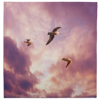 Seagulls flying in a sunset sky napkin