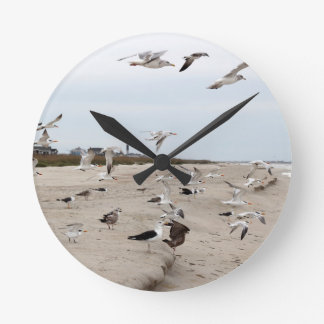 Seagulls Flying, Standing and Eating on the Beach Round Clock