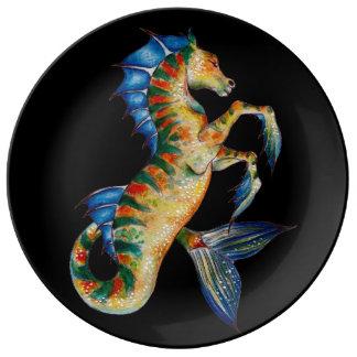 seahorse on black plate
