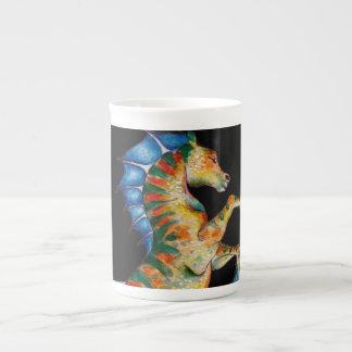 seahorse on black tea cup