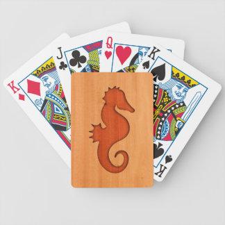 Seahorse silhouette on wood poker deck