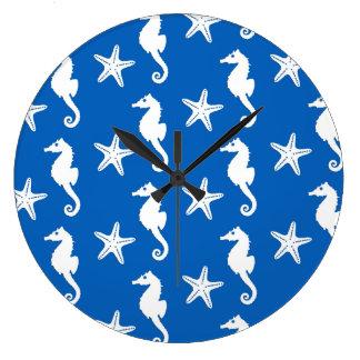 Seahorse & starfish - white on cobalt blue wall clocks