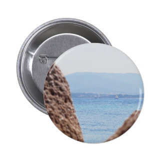 Seascape of Tavolara island on blurred rocks foreg 6 Cm Round Badge