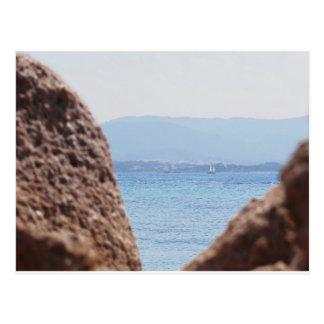 Seascape of Tavolara island on blurred rocks foreg Postcard