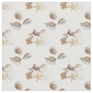 Seashells gallore on white fabric