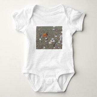 Seashells on sand. Summer beach background Baby Bodysuit