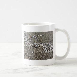 Seashells on sand. Summer beach background Coffee Mug