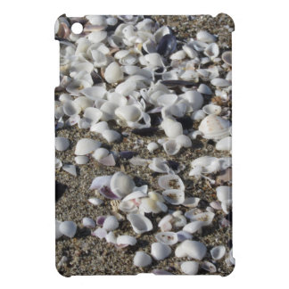 Seashells on sand. Summer beach background Cover For The iPad Mini