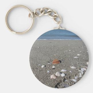 Seashells on sand. Summer beach background Key Ring