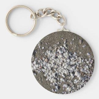 Seashells on sand. Summer beach background Key Ring