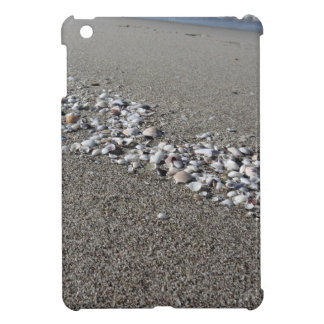Seashells on sand Summer beach background Top view iPad Mini Covers