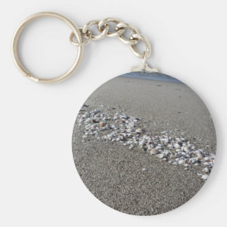 Seashells on sand Summer beach background Top view Key Ring