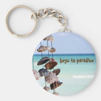 seashells on sea background key ring