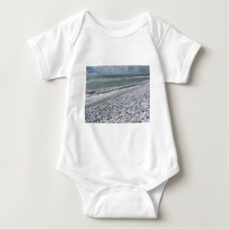 Seashore of a beach in a cloudy day at summer baby bodysuit