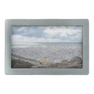 Seashore of a beach in a cloudy day at summer belt buckles