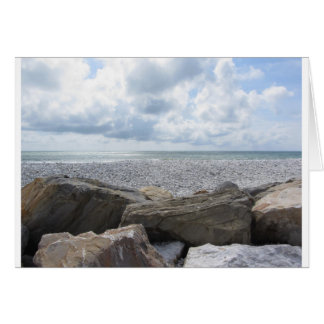 Seashore of a beach in a cloudy day at summer card