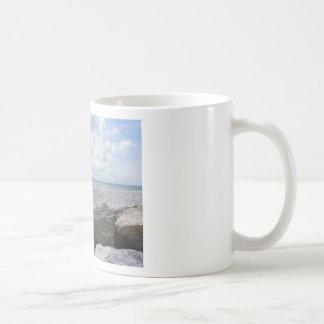 Seashore of a beach in a cloudy day at summer coffee mug