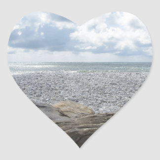 Seashore of a beach in a cloudy day at summer heart sticker