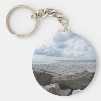 Seashore of a beach in a cloudy day at summer key ring