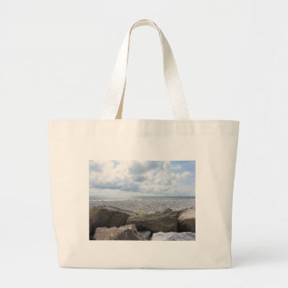 Seashore of a beach in a cloudy day at summer large tote bag
