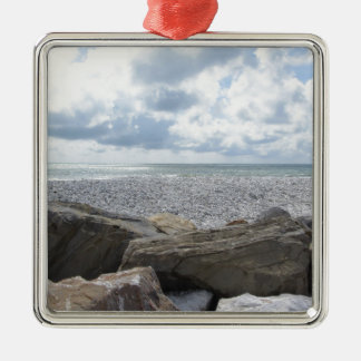 Seashore of a beach in a cloudy day at summer metal ornament