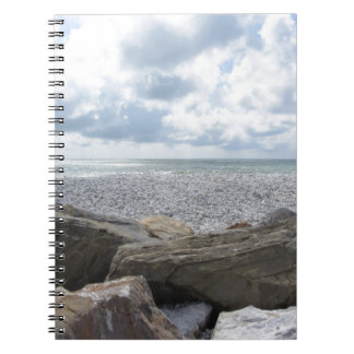 Seashore of a beach in a cloudy day at summer notebook
