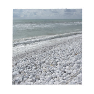 Seashore of a beach in a cloudy day at summer notepad