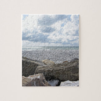 Seashore of a beach in a cloudy day at summer puzzle