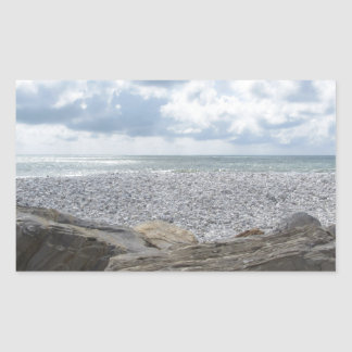 Seashore of a beach in a cloudy day at summer rectangular sticker