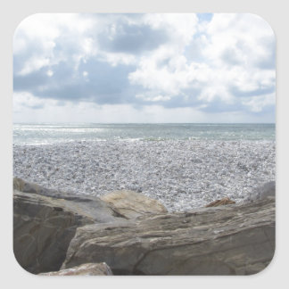 Seashore of a beach in a cloudy day at summer square sticker