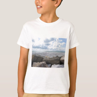 Seashore of a beach in a cloudy day at summer T-Shirt