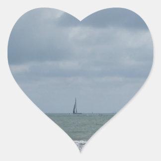 Seashore of beach during regatta at summer heart sticker