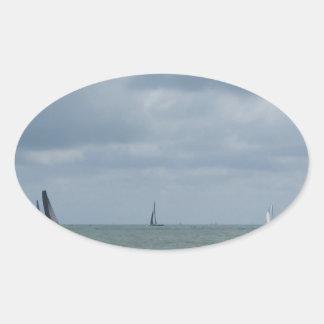 Seashore of beach during regatta at summer oval sticker