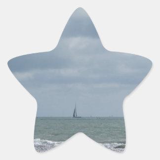 Seashore of beach during regatta at summer star sticker