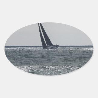 Seashore of beach during regatta oval sticker