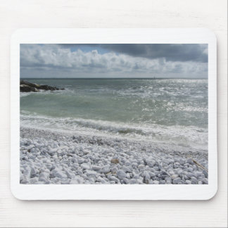 Seashore of beach in a cloudy day at summer mouse pad