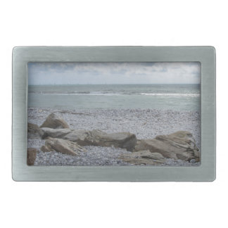Seashore of beach with sailboats on the horizon belt buckle