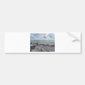 Seashore of beach with sailboats on the horizon bumper sticker