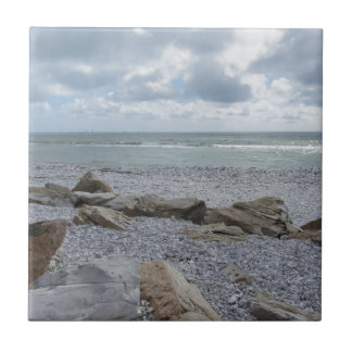 Seashore of beach with sailboats on the horizon ceramic tile