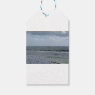 Seashore of beach with sailboats on the horizon gift tags