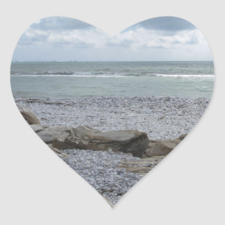 Seashore of beach with sailboats on the horizon heart sticker