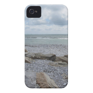 Seashore of beach with sailboats on the horizon iPhone 4 case